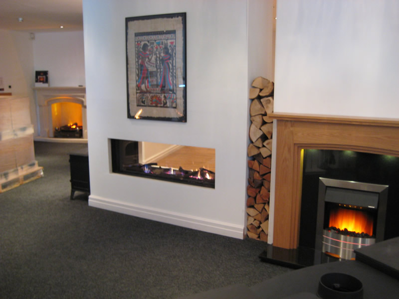 Hole in The Wall Fireplaces in Showroom